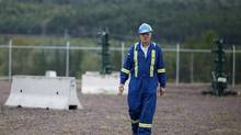 Doug Bailey site manager of Corridor Resources Inc. production operations works at a well pad in Penobsquis, N.B., Sept. 5, 2013. New Brunswick is fracking's newest battleground, but Mr. Bailey says relations with the community are 'relatively good,' and the company closely monitors its operations with sensing equipment to ensure safety. (The Globe and Mail)