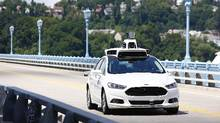 Technologies such as Uber's self-driving car are going to render traditional human jobs obsolete in coming decades, and no amount of rhetoric from the president-elect – or anybody else – will stop them. (Jared Wickerham/The Associated Press)