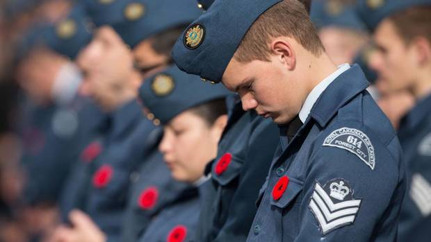 An air cadet bows his head in prayer during Remembrance Day ceremony at the Cenotaph in London Ontario, Sunday, November 11, 2012. (Geoff Robins/THE CANADIAN PRESS)