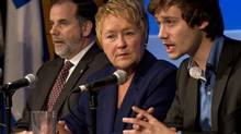 Quebec Premier Pauline Marois, Education Minister Pierre Duchesnes , left, and MP and former student leader Leo Bureau-Blouin speak to reporters about the upcoming education summit Thursday, November 8, 2012 in Montreal. (Ryan Remiorz/The Canadian Press)