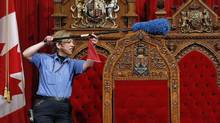 A worker cleans the Senate chamber in Ottawa on June 1, 2011. (CHRIS WATTIE/REUTERS)
