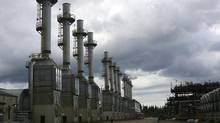 Rows of steam generating plants at Cenovus Energy's Christina Lake oil sands operation in Christina Lake, Alberta, Canada, June 12, 2013. (Richard Perry/NYT)