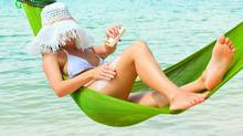 Sunburnt woman applying sunblock on her body at the beach. (Thinkstock/Thinkstock)
