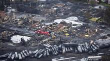 Workers comb through debris on July 9, 2013 following the train derailment in Lac-Mégantic, Que. (Paul Chiasson/THE CANADIAN PRESS)