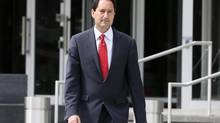 Montreal mayor Michael Applebaum walks out of Surete du Quebec headquarters after his arrest in Montreal, June 17, 2013. Applebaum was arrested at his home Monday morning and was charged with 14 offences including breach of trust, fraud, municipal corruption, conspiracy and receiving secret commissions, according to the head of the anti-corruption team, Robert Lafreniere. (Christinne Muschi/Reuters)