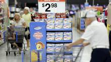 In this Friday, July 12, 2013, file photo, customers shop at a Wal-Mart, in Bristol, Pa. (Matt Rourke/AP)