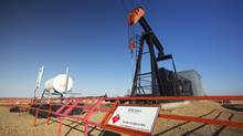 Pump jack pumps oil at an Encana well near Standard, Alta., May 12, 2014. (Todd Korol For The Globe and Mail)