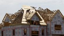 File photo of a builder working on the roof of a new home under construction in the Montreal suburb of Brossard. (© Shaun Best / Reuters/REUTERS)