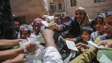 Yemenis receive food rations provided by a local charity, in Sanaa, Yemen, on April, 13, 2017. (Hani Mohammed/AP)