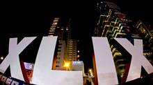 The Roman numerals for Super Bowl XLIX stand in front of high rise building Wednesday, Jan. 28, 2015, in downtown Phoenix. (Charlie Riedel/AP)