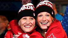 Canada's Kaillie Humphries, left, and Heather Moyse, celebrate winning a gold medal in women's bobsled competition at the Whistler Sliding Centre at the 2010 Vancouver Olympic Winter Games in Whistler, B.C., Wednesday, Feb. 24, 2010. (The Canadian Press)