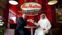 Foreign Affairs Minister John Baird has a cup of coffee with his UAE counterpart, Sheikh Abdullah Bin Zayed Al Nahyan, at the Tim Hortons at Abu Dhabi Mall in Abu Dhabi on April 2, 2013. Christopher Pike / The National (Christopher Pike/The National)