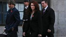 Former News of the World national newspaper editor Rebekah Brooks, accompanied by her husband Charlie Brooks, left, leaves the Central Criminal Court in London, Monday, Oct. 28, 2013. (Lefteris Pitarakis/AP)