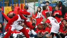 The Raptor, the official mascot of the Toronto Raptors, goes toe to toe with Toronto school students in this photo from 2007. (Tim Fraser For The Globe and Mail)