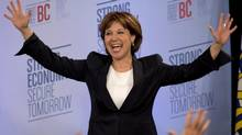 B.C. Liberal Leader Christy Clark waves to the crowd as she arrives on stage after winning the British Columbia provincial election, in Vancouver, May 14, 2013. (JONATHAN HAYWARD/THE CANADIAN PRESS)