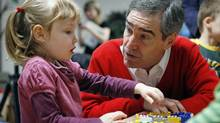 Liberal Leader Michael Ignatieff interacts with student Payton Kelly before reading a book to a pre-kindergarten class, at an early childhood learning centre in Ottawa on October 20, 2009. (BLAIR GABLE)