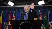Liberal MP Marc Garneau gestures during a press conference on Parliament Hill in Ottawa on March 13, 2013, to announce his withdrawal from the Liberal leadership race. (Sean Kilpatrick/CP)
