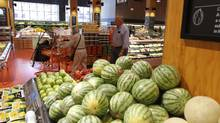 Consumers shop at a Toronto Loblaw store. (Fernando Morales/The Globe and Mail)