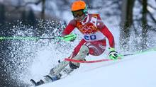Switzerland's Sandro Viletta skis in the slalom portion of the men's supercombined to win the gold medal at the Sochi 2014 Winter Olympics, Friday, Feb. 14, 2014, in Krasnaya Polyana, Russia. (Associated Press)