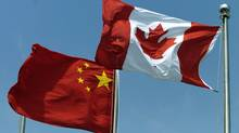 The Chinese flag flies beside the Maple Leaf in Shanghai. (Fred Lum/Fred Lum/The Globe and Mail)