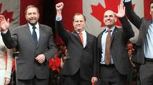 NDP leadership candidates Thomas Mulcair, Brian Topp and Nathan Cullen, Paul wave to the crowd during the NDP leadership debate in Vancouver, (BEN NELMS/REUTERS)