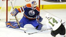 Dallas Stars' Jamie Benn, right, scores on the Edmonton Oilers' Devan Dubnyk during second period NHL hockey action in Edmonton on Friday, Jan. 22, 2010. (John Ulan/John Ulan/The Canadian Press)