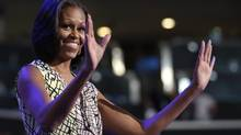 First Lady Michelle Obama waves as she appears at the podium for a camera test on the stage at the Democratic National Convention inside Time Warner Cable Arena in Charlotte, N.C., on Monday, Sept. 3, 2012. (Jae C. Hong/AP)