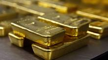 Gold bars are stacked in the safe deposit boxes room of the Pro Aurum gold house in Munich. (MICHAEL DALDER/REUTERS)