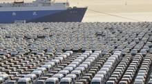 Cars are parked at a port in Dalian, Liaoning province, waiting for export. China will have annual exports of two million cars by 2016, say almost half the respondents of a KPMG auto industry survey. (CHINA DAILY/REUTERS)