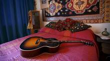 Replica items, including a guitar, in the bedroom of the home where Jimi Hendrix and girlfriend Kathy Etchingham lived in 1968-69 London, February 8, 2016. The third floor Mayfair flat will open to the public on February 10, following at 2.4 million pound, two year restoration, which is also the former home of composer, George Frederic Handel. (PETER NICHOLLS/REUTERS)