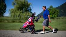 Grand Chief Doug Kelly, Chair of the First Nations Health Council, pushes his golf clubs on a cart while playing a round at Royalwood Golf Course in Chilliwack, B.C., on Saturday June 15, 2013. Chief Kelly walks the golf course every weekend for exercise. (DARRYL DYCK FOR THE GLOBE AND MAIL)