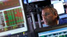 A trader works on the floor of the New York Stock Exchange on Aug. 31, 2012. (Jason DeCrow/The Associated Press)