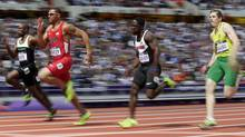Ivory Coast's Ben Youssef Meite, United States' Ryan Bailey, Canada's JustynWarnerand Lithuania's Rytis Sakalauskas (left to right) compete in a men's 100-metre heat during the athletics in the Olympic Stadium at the 2012 Summer Olympics, London, Saturday. (David J. Phillip/Associated Press)