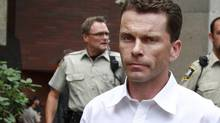 Shawn Woodward is flanked by sherrifs as he leaves a B.C. provincial courthouse in Vancouver August 9, 2010. after being found guilty of aggravated assault. Woodward was charged after Ritchie Dowrey was punched and knocked unconscious while playing pool last March at a pub in the city's West End. (Jeff Vinnick/The Globe and Mail/Jeff Vinnick/The Globe and Mail)