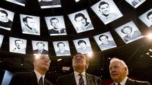Former Montreal Canadiens' players (from left) Rejean Houle, Serge Savard and Yvan Cournoyer, take a look at photos of past players during a tour of the newly inaugurated Montreal Canadiens Hall of Fame in Montreal, Friday, Jan., 15, 2010. THE CANADIAN PRESS/Graham Hughes (Graham Hughes)