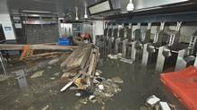 Debris litters the entrance inside the South Ferry subway station after it was flooded by seawater in the aftermath of Hurricane Sandy in this handout photo supplied by the Metropolitan Transportation Authority in New York Oct. 31, 2012. (HANDOUT/REUTERS)