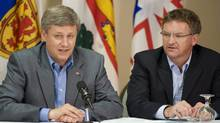 Prime Minister Stephen Harper, left, and Fabian Manning address the Conservative Atlantic Caucus in Fredericton on Aug.14, 2008. (Michael David Smith/Michael David Smith/The Canadian Press)