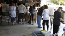 Voters cast their ballots in the garage of Tom and Carol Marshall, which was converted into a polling location during the U.S. presidential election in Los Angeles, California. (FRED PROUSER/REUTERS)