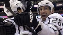 Los Angeles Kings Jarret Stoll, right, celebrates with Justin Williams after a goal Monday night against the Toronto Maple Leafs. (Chris Young/The Canadian Press)