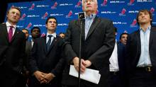 Donald Fehr (centre) Executive Director of the NHLPA stands with Sidney Crosby and Alex Ovechkin of the Washington Capitals (right) as they face the press following collective bargaining talks in Toronto on Tuesday August 14, 2012. Negotiations continue between the NHL and the NHLPA to avoid a potential lockout . (Chris Young/THE CANADIAN PRESS)
