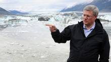 Prime Minister Stephen Harper visits Lowell Glacier in Kluane National Park, Yukon on Friday, August 26, 2011. (Sean Kilpatrick/THE CANADIAN PRESS)