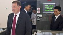 Foreign Minister John Baird walks out of a Boeing 737-800 flight simulator at Air China's training center in Beijing on July 19, 2011. (Alexander F. Yuan/AP)