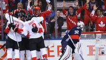 Team Canada celebrates after one of three first-period goals against Jonathan Quick and Team USA during the World Cup at Air Canada Centre in Toronto on Tuesday. (Bruce Bennett/Getty Images)