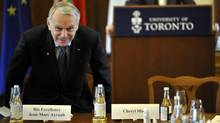 French Prime Minister Jean-Marc Ayrault takes his seat upon arriving at a roundtable discussion while touring the University of Toronto, March 14, 2013. (J.P. MOCZULSKI FOR THE GLOBE AND MAIL)