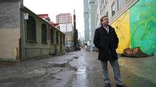 Mark Garner in the laneway behind Victoria Street, Toronto. (Dave LeBlanc for the Globe and Mail)