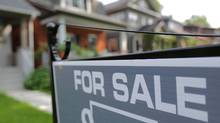 A sign advertises a house for sale as Canada's central bank announced its first interest rate hike in nearly seven years, on a residential street in midtown Toronto, Ontario, Canada July 12, 2017. (CHRIS HELGREN/REUTERS)