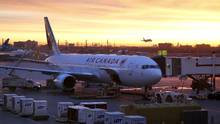 An Air Canada airplane is prepared at dawn for boarding at Pearson International Airport in Toronto March 31, 2015. (CHRIS HELGREN/REUTERS)