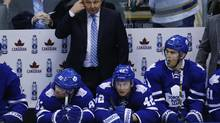 Toronto Maple Leafs head coach Randy Carlyle looks on with his team during a break in play with players (L-R) Phil Kessel, Tyler Bozak, and James van Riemsdyk against the St. Louis Blues during the second period of their NHL hockey game in Toronto, Tuesday, March 25, 2014. (Mark Blinch for The Globe and Mail)