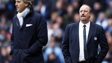 Chelsea's manager Rafa Benitez, right, and his Manchester City counterpart Roberto Mancini watch their English Premier League soccer match at The Etihad Stadium in Manchester, northern England, February 24, 2013. (DARREN STAPLES/REUTERS)