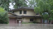 1334 Riverdale Ave., Calgary one day after the flood in June, 2013. (Jerry Schwartz)